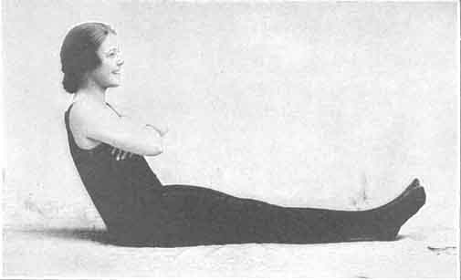 Lying on the back with arms folded, raising body to a sitting position